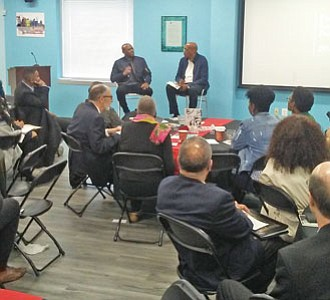 "Celebrated actor Omar Epps with Center for Urban Families founder and CEO Joe Jones at the annual Practitioners Leadership Institute summit on October 20, 2018 in West Baltimore where Epps was the featured speaker. He engaged  members of the community in a conversation about his newly released book, ""From Fatherless to Fatherhood."""