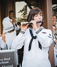 Petty Officer 2nd Class Haley Cameron plays the flute while serving with the Navy Band Northeast.