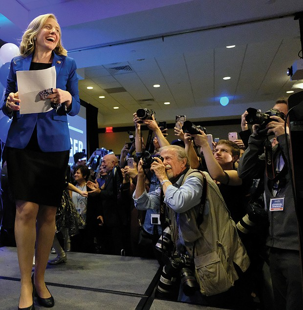 Democrat Abigail Spanberger of Henrico heads to the podium late Tuesday night to claim a razor-thin victory in the 7th Congressional District contest against incumbent GOP Rep. Dave Brat.
