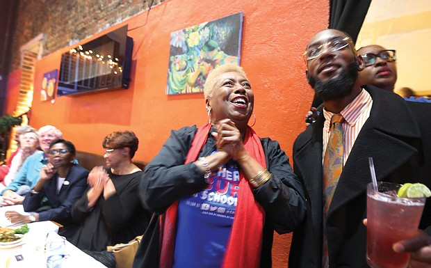 Cheryl L. Burke beams with excitement as she watches the election results roll in Tuesday night at a victory party with family, friends and supporters at a restaurant in Shockoe Bottom.