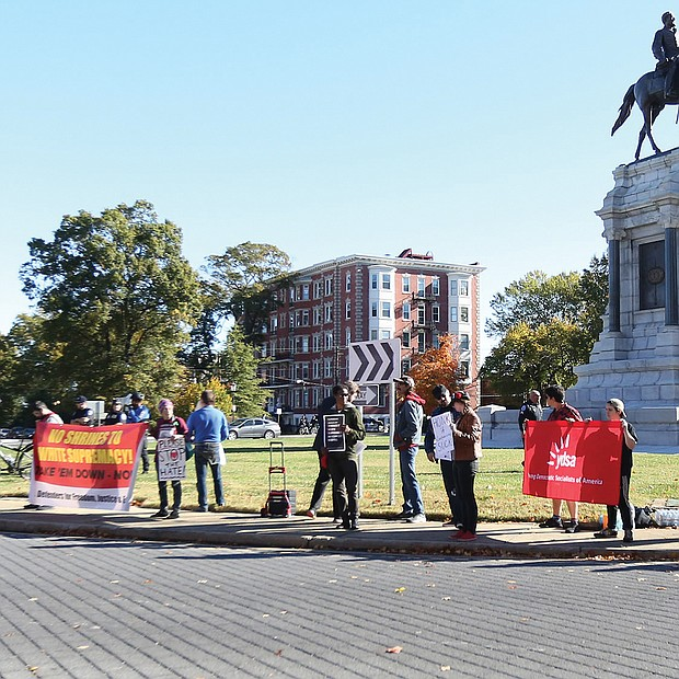 Point, counterpoint: About 20 neo-Confederates with the CSA II: New Confederate States of America and the Virginia Task Force 3 Percenters-Dixie Defenders were met with a like number of counterprotesters last Saturday at the statue of Confederate Gen. Robert E. Lee on Monument Avenue. (Regina H. Boone/Richmond Free Press)