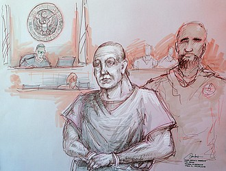 Cesar Sayoc, left, who is charged with sending pipe bombs to prominent Democrats around the country, appears in federal court in Miami on Oct. 29 in this courtroom sketch. The 56-year-old was transferred on Monday to New York City, where he will be tried.