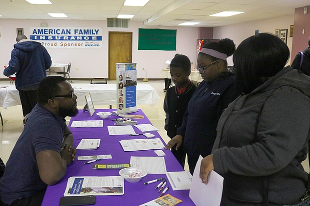 Attendees meet with representatives of historically black colleges and universities at the Betty Mahone Black College Fair, held Sunday in Joliet. (Megann Horstead/For The Times Weekly)