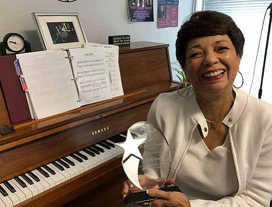 Bobbi Wilsyn, long-time Columbia College Chicago faculty member and coordinator of the Vocal Studies program, received a 2018 Black Excellence ...