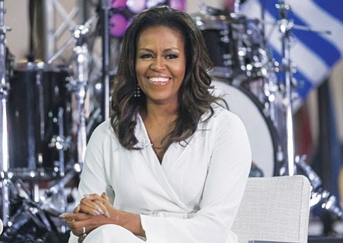 Former first lady Michelle Obama finds some criticism for President Donald Trump in her new book, writing how she reacted ...