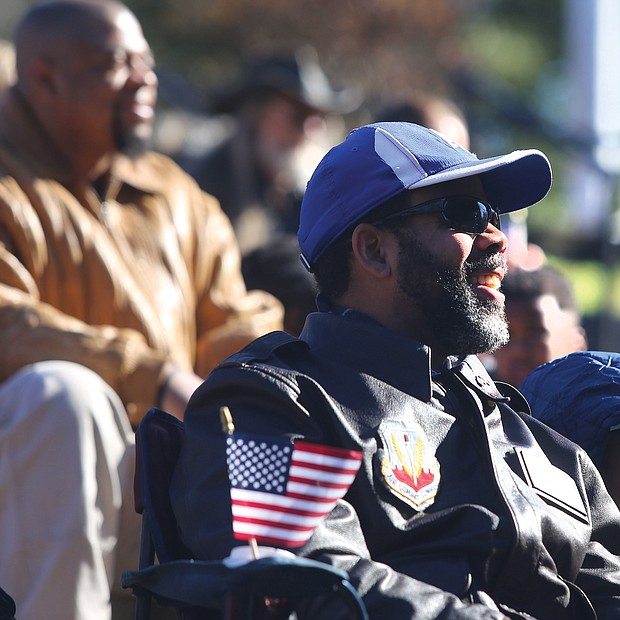 Commissioner John L. Newby II, with the Department of Veteran Services of the Commonwealth of Virginia participates in the Commonwealth's Veterans Day ceremony at Dogwood Dell Sunday , Nov. 11, 2018, the 100th anniversary of Armistice Day with his daughter Jillian Newby, 9, both of Henrico County. 