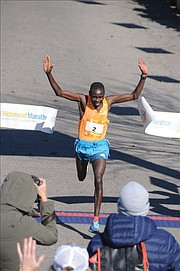 Boaz Kipyego of Kenya crosses the finish line near Brown's Island last Saturday to win the 41st Annual Richmond Marathon. He finished the 26.2 mile race in 2:20:44, taking home the $2,500 prize.