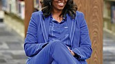Former First Lady Michelle Obama speaks with students on Monday at Whitney M. Young Magnet High School in Chicago.