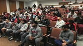 Members of the Virginia Union University football team wait last Sunday to hear the team's name called for a berth in the NCAA regional playoffs. Despite an 8-2 record, the Panthers were disappointed and missed the cut.