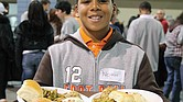 Volunteer Noah Crockett serves Thanksgiving meals at The Giving Heart Community Thanksgiving Feast in Downtown in 2010.