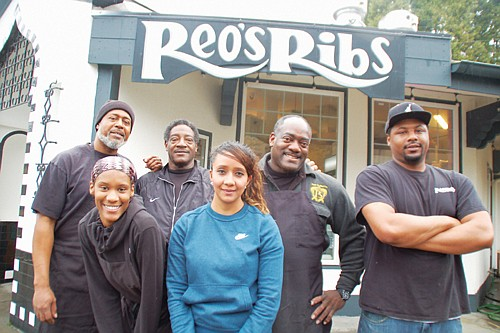 A popular soul food joint, Reo's Ribs, is back in full-force at its location in the Hollywood District after making repairs from a 2017 fire. Pictured are members of the Reo's Ribs team, Joseph Grant (left), Isabell Garcia, owner Reo Varnado, Deja Willingham, Rick Varnado, and Ron Varnado.