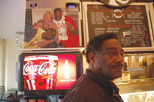 Reo Varnado, the proprietor of Reo's Ribs, at his signature Southern barbecue restaurant in the Hollywood District.  A photo of Varnado with his famous nephew Snoop Dogg and Martha Stewart dons the newly renovated interior.