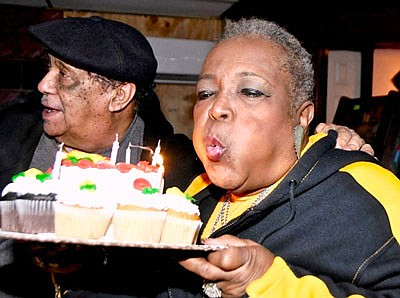 """Rosa and her :Boo-Boo"""" (Shorty) at Roots Lounge on Smallwood and Vine Streets in West Baltimore.  I needed a lot of wind to blow out all my candles on my cake."""