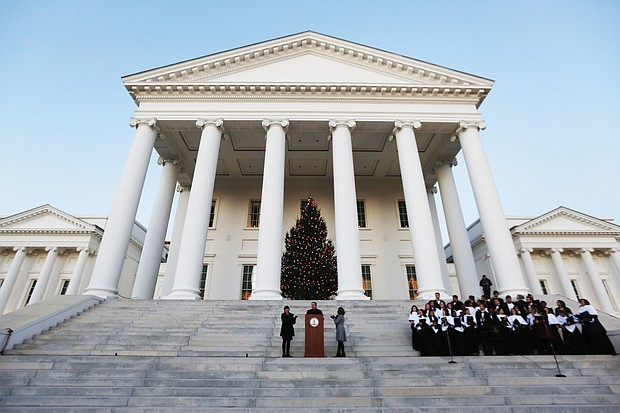 Gov. Ralph S. Northam and First Lady Pamela Northam light the official Virginia Capitol Christmas tree that stands on the South Portico of the Capitol. Participating in the ceremony Wednesday night are the Eastern View High School Troubadors from Culpeper County and Bettina Ring, state secretary of agriculture and forestry. The tree lighting touches off many of the area's holiday festivities that will take place Friday and Saturday.