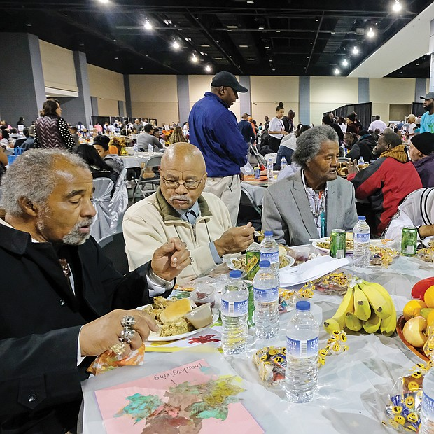 Giving thanks: Hundreds of people enjoyed a sumptuous dinner on Thanksgiving Day at The Giving Heart Community Thanksgiving Feast at the Greater Richmond Convention Center in Downtown. The annual event is free and draws hundreds of volunteers and contributors who provide fellowship and service to families and individuals sitting down for dinner. Among those enjoying the food are, top from left, Harry Howell, Henry Munford, Royal Munford, Mary Singh and Josephine Munford. Behind the scenes, volunteers are hard at work preparing plates with turkey and all the fixings. (Sandra Sellars/Richmond Free Press)