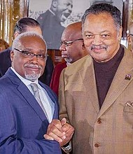 The Mayor of the Village of Robbins, Tyrone Ward (left), pictured with Rev. Jesse Jackson at the recent Robbins Day celebration. Photo Credit: Rainbow/PUSH.