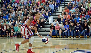 Hoops Green brings the flash as a member of the Harlem Globetrotters