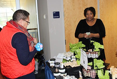 Kathy Reevie purchases shea butter from Monika Robinson (Mo Natural Beautiful')