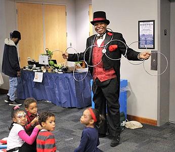 Magician John Carrington entertains Dean, Reagan, Cole and Sydney.