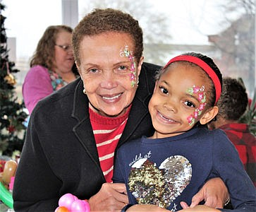 Baltimore Times publisher Joy Bramble and granddaughter Sydney.