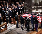 The flag-draped casket of former President George H.W. Bush is carried into Washington National Cathedral on Wednesday by military pallbearers past his son, left, former President George W. Bush, and in the pew at right, President Trump and First Lady Melania Trump; former President Barack Obama and Michelle Obama; former President Bill Clinton and Hillary Clinton; and former President Jimmy Carter and Rosalynn Carter.