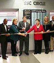 Pictured with Scissors: South Suburban College's Robin Rihacek, Executive Director of Enrollment & Retention Services and Frank Zuccarelli, Chairman of the Board of Trustees, cut the ribbon to officially open SSC Circle, a new student assistance facility at the college's Main Campus in South Holland
