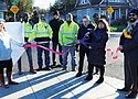 Portland Bureau of Transportation Commissioner Chloe Eudaly, Interim Transportation Director Chris Warner, join city staff and crew members Thursday to cut the ceremonial ribbon and celebrate the newly-completed  Southeast 50th Paving Project.