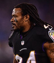 Baltimore Ravens cornerback Brandon Carr celebrates as he is being introduced before the game against  the Indianapolis Colts at M&T Bank Stadium in Baltimore, last month.
