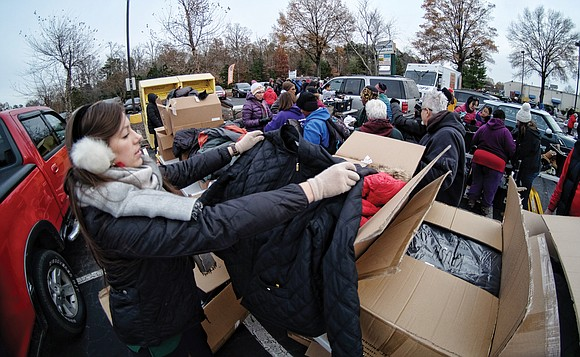 Several hundred new winter coats were distributed to people of all ages last week by two different organizations, just in ...