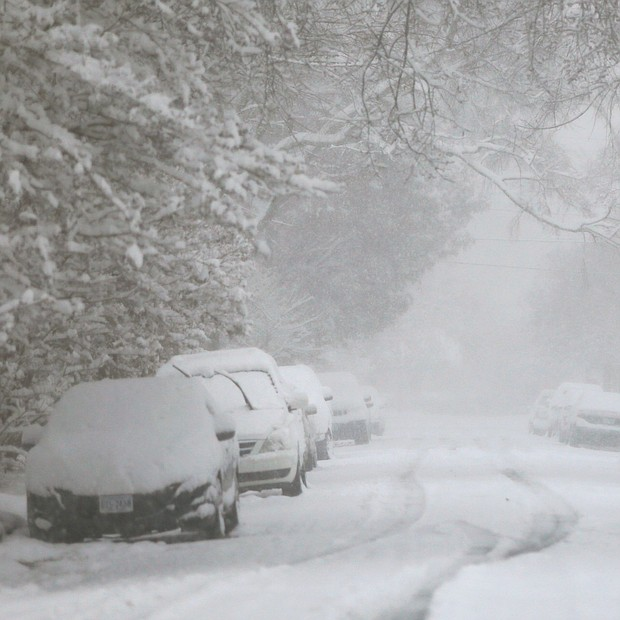 A wind-blown blanket of snow covers the parked cars and pavement on a North Side street. The wintry scene is just one example of the impact of Sunday's storm that dropped nearly a foot of snow on the area — the largest amount on record for Metro Richmond for a snowfall prior to Dec. 10, and the second largest snowfall for December since 1908. (Regina H. Boone/Richmond Free Press)