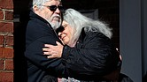 Susan Bro, mother of 32-year-old paralegal Heather Heyer, hugs her husband, Kent Bro, on the steps of the Charlottesville courthouse Tuesday after a jury recommended that the avowed neo-Nazi who killed her daughter in August 2017 spend the rest of his life in prison.