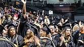 Virginia Commonwealth University fall commencement speaker Christy Coleman offers graduates words of advice during a ceremony last Saturday at the Siegel Center. Graduates celebrate their new degrees during the ceremony.