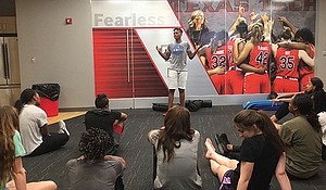 Alicia Thompson, 2004 WNBA Champion for the Seattle Storm, speaks to a group of young athletes at  Flow Performance Training and Wellness
