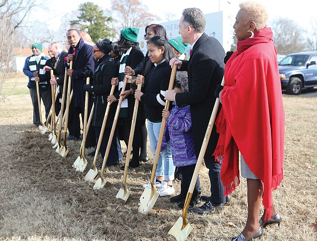 Richmond Mayor Levar M. Stoney, center, asks Superintendent Jason Kamras, second from right, to lead Wednesday's groundbreaking ceremony at E.S.H. Greene Elementary School in Spanish in recognition of the large Spanish-speaking population at the South Side school. Mr. Kamras offered some of his remarks to the small crowd of students, school officials, School Board and City Council members in Spanish.