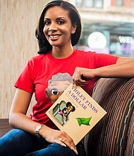 Kenyatta Scott (pictured) is the author of The Violet Book Series, a series of morally based children books. Photo Credit: Amber Green