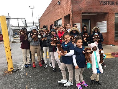 Girl Scouts with their bears outside the Maryland Correctional Institution for Women.