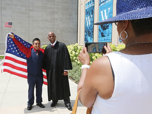 Richmond resident Beato Hernandez, 33, a native of Mexico, poses for a photo with Judge Roger L. Gregory, chief judge of the 4th U.S. Circuit Court of Appeals. Mr. Hernandez became a U.S. citizen in a naturalization ceremony in July outside the Virginia Museum of History and Culture.