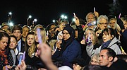 Hundreds of people of different faiths, races and backgrounds raise lights of hope in a show of unity and love during a vigil at the Weinstein Jewish Community Center on Monument Avenue in October following a mass shooting at the Tree of Life Synagogue in Pittsburgh in which 11 people were killed.