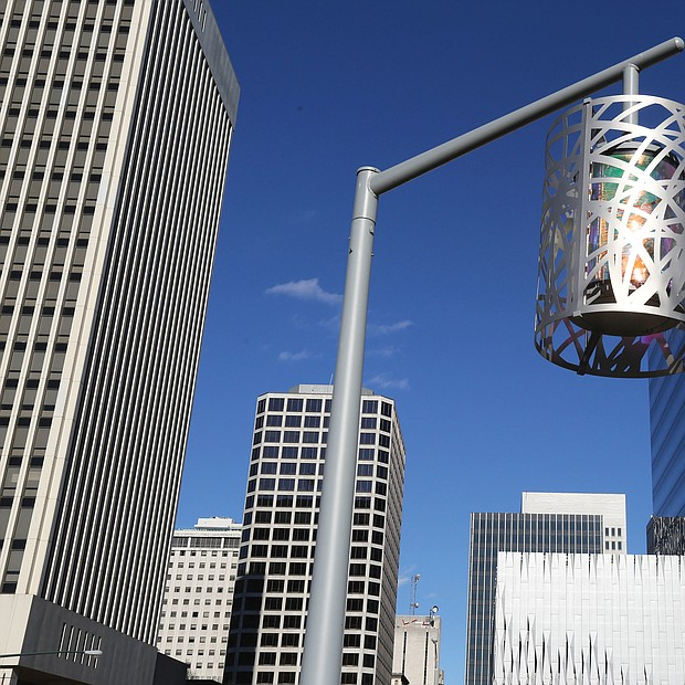 This stylish and decorative streetlight, set against the backdrop of the Richmond skyline, stands in Kanawha Plaza, the city park at 8th and Canal streets in Downtown. The look is part of a $2.9 million makeover completed in 2016 for the park, which previously was an informal shelter for the homeless. The previous traditional globe streetlights often were broken. The Enrichmond Foundation is in charge of fundraising for the park to cover the cost of maintenence and events. (Regina H. Boone/Richmond Free Press)