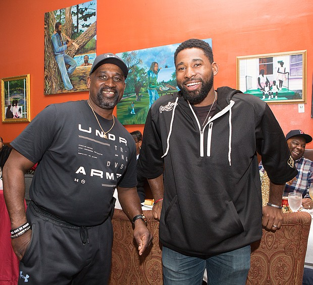 Hometown celebration: Boston Red Sox centerfielder Jackie Bradley Jr., right, spends time with his dad, Jackie Bradley Sr. of Richmond, during a celebration held for the pair on Dec. 28 by the older Mr. Bradley's co-workers at GRTC. In late October, the younger Mr. Bradley helped the Red Sox clinch a World Series victory over the Los Angeles Dodgers. A Richmond area native, he played ball for Prince George High School and the University of South Carolina before joining the Red Sox, where he has been the starting centerfielder since 2014. His dad is a veteran bus driver for GRTC. The festive celebration was held at Southern Kitchen restaurant in Shockoe Bottom. (James Haskins/Richmond Free Press)