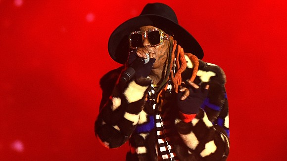 Forget the game. Let's discuss Lil Wayne's outfit during the College Football Playoff National Championship halftime show.