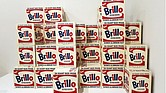 "Andy Warhol's ""Brillo Boxes"" on display at the Whitney Museum. Each box contains the OU kosher symbol, shown above, in the bottom left corner above the word ""Shines."""