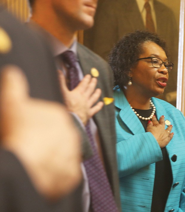 New year, new session: Sussex County Delegate Roslyn C. Tyler joins in the Pledge of Allegiance on opening day in the House of Delegates. (Regina H. Boone/Richmond Free Press)