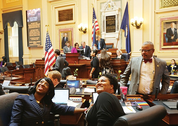 New General Assembly session Petersburg Delegate Lashrecse D. Aird and her seatmate, Newport News Delegate Marcia S. Price, look up as a person in the upstairs gallery takes their photo. Looking on is Delegate Luke E. Torian of Prince William County. Scenes like this were commonplace Wednesday as the General Assembly opened its 2019 session, which is expected to run about 46 days. Legislators, whose seats will be up for election in November, will be rushing during the short session to get through a sea of bills and amend the current two-year budget before adjourning in late February. (Regina H. Boone/Richmond Free Press)