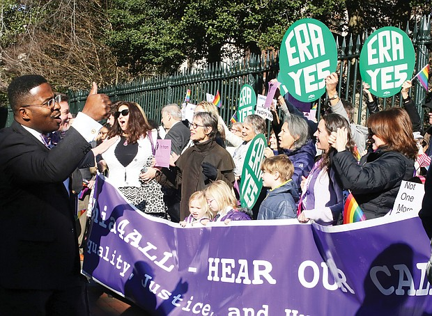 """New year, new session: Chesapeake Delegate C.E. """"Cliff"""" Hayes Jr. gives a thumbs-up Wednesday to advocates in Capitol Square urging the legislature to pass the Equal Rights Amendment to give equal status to women under the U.S. Constitution. (Regina H. Boone/Richmond Free Press)"""