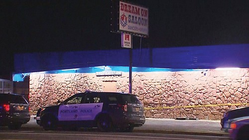 Authorities said a man died after being shot by a security guard outside a southeast Portland strip club early Tuesday ...