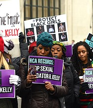 Protesters outside Sony Music demanding the label drop R. Kelly