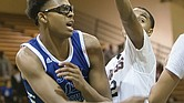 Sophomore Roosevelt Wheeler, left, is John Marshall's 6-foot-10 shot blocker working under the basket.