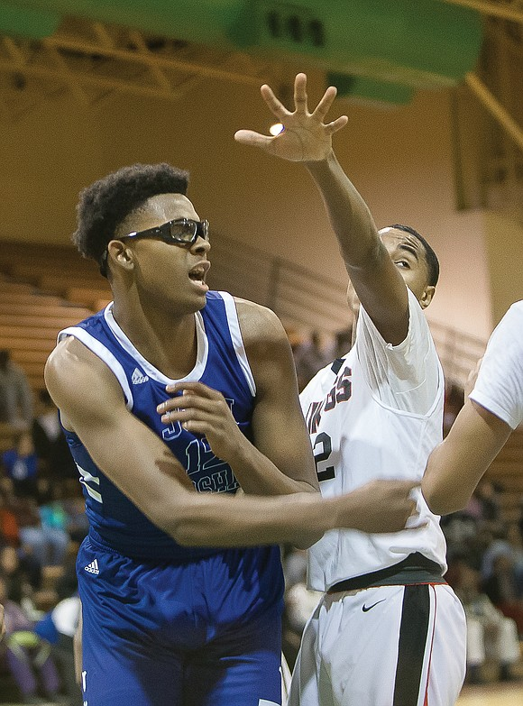 Sophomore Roosevelt Wheeler is John Marshall High's tall secret