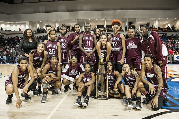 The VUU Lady Panthers pose with their Freedom Classic championship trophy after defeating VSU 73-49 last Saturday.